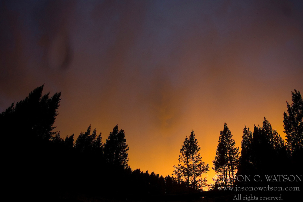 The sunset of Mary Mountain in Yellowstone National Park creates the illusion of fire in the sky, Wyoming.
