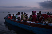 SEBAGORO, UGANDA - MARCH 23: A boat filled with Congolese refugees lands at Sebagoro, Uganda on March 23, 2018. Violence in Ituri Province in northeastern Democratic Republic of Congo has displaced more than 400,000 people including approximately 40,000 refugees who have fled to Uganda. (Photo by Andrew Renneisen for The Washington Post)