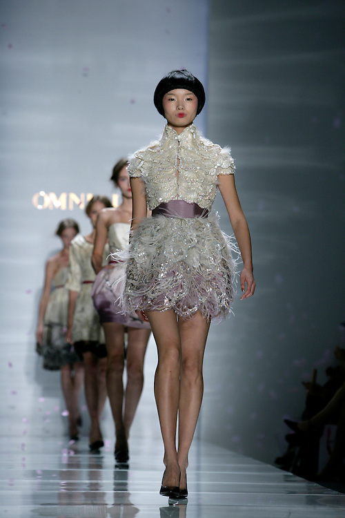 Chinese Fashion Designer Cindy Luo (Luo Zheng, 罗峥)showed her Spring/Summer 2009 Women's collection in New York Fashion Week Sept 12, 2008. It was the first time she was invited to the Bryant Park in New York City.  The theme was beauty blossoms.  And her brand is OMNIALUO.
