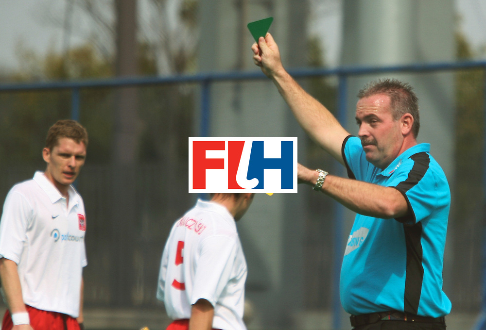 Kakamigahara (Japan): Grime Murray, the umpire from Australia shows the green card to Dutkiewick Tomasz of Swiss in the match against Malaysia in the Olympic Hockey Qualifier in Gifu Perfectural Green Stadium at Kakamigahara on 05 April 2008.  Photo: GNN/ Vino John.