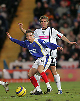 Photo: Lee Earle.<br /> Portsmouth v West Bromwich Albion. The Barclays Premiership. 17/12/2005. Portsmouth's Matthew Taylor (F) holds off Martin Albrechtsen.