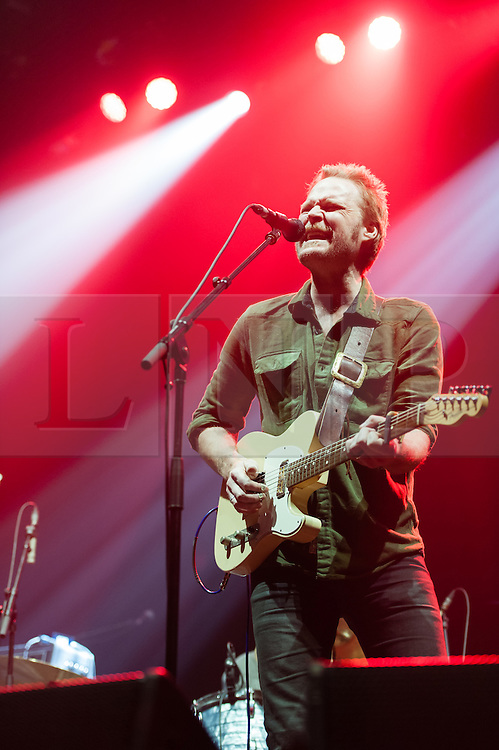 © Licensed to London News Pictures. 10/12/2014. London, UK.   Hiss Golden Messenger performing live at Brixton Academy, supporting headliner Ben Howard.  In this picture Scott Hirsch.  Hiss Golden Messenger is an American folk music duo, originating from North Carolina consisting of MC Taylor and Scott Hirsch.   Photo credit : Richard Isaac/LNP
