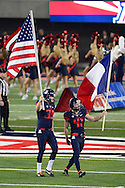 TUCSON, AZ - NOVEMBER 14: Punter Drew Riggleman #39 and place kicker Casey Skowron #41 of the Arizona Wildcats carry out the American and French flag prior to the game against the Utah Utes at Arizona Stadium on November 14, 2015 in Tucson, Arizona.  (Photo by Jennifer Stewart/Getty Images)