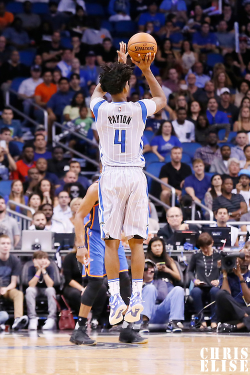 30 October 2015: Orlando Magic guard Elfrid Payton (4) takes a jump shot during the Oklahoma City Thunder 139-136 double overtime victory over the Orlando Magic, at the Amway Center, in Orlando, Florida, USA.