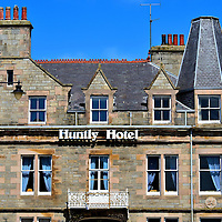 Huntly Hotel on The Square in Huntly, Scotland <br /> The Huntly Hotel&rsquo;s Victorian fa&ccedil;ade was constructed in 1903. It offers quaint, boutique accommodations for travelers of northeast Scotland and scotch enthusiasts bound for the Malt Whiskey Trail.  Also popular is the Gordon Arms Hotel.  Both are anchors of The Square, the center of Huntly which was laid out in 1769 by Alexander Gordon, the 4th Duke of Gordon.