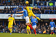 Kwesi Appiah (9) of AFC Wimbledon heads the ball as Matt Clarke (5) of Portsmouth challenges during the EFL Sky Bet League 1 match between Portsmouth and AFC Wimbledon at Fratton Park, Portsmouth, England on 1 January 2019.