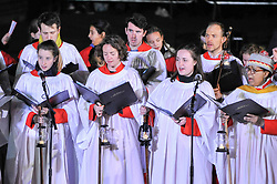 © Licensed to London News Pictures. 07/12/2017. London, UK.  The choir from St. Martins in the Fields sings during the ceremony for the annual lighting of the Christmas Tree in Trafalgar Square.  The tree, a Norwegian spruce, is donated by the City of Oslo to the people of London each year as a token of gratitude for Britain's support during the Second World War.  Photo credit: Stephen Chung/LNP