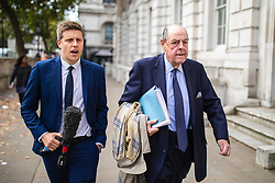 "© Licensed to London News Pictures. 03/09/2019. London, UK. Sir Nicholas Soames (R), believed to be one of the Tory ""rebels"" willing to vote against the government, arrives at the Cabinet Office. MPs return from recess today and may vote on legislation to block a no deal exit from the European Union. Photo credit: Rob Pinney/LNP"