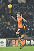 Hull City defender Michael Dawson heads ball and sustains an injury in doing so  during the Sky Bet Championship match between Hull City and Bolton Wanderers at the KC Stadium, Kingston upon Hull, England on 12 December 2015. Photo by Ian Lyall.