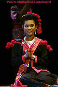 A woman clad in traditional Southern Thai garb performs during the annual Krabi Dance Festival in Krabi, Thailand.