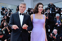 Hollywood star George Clooney was treated in hospital on Tuesday for minor injuries after a scooter accident in Sardinia, Italy on July 10, 2018 ------------ George Clooney and Amal Clooney attending the Suburbicon Premiere during the 74th Venice International Film Festival (Mostra di Venezia) at the Lido, Venice, Italy on September 02, 2017. Photo by Aurore Marechal/ABACAPRESS.COM
