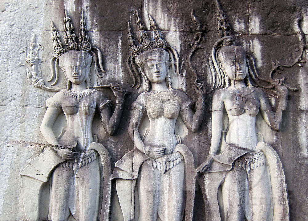 Detail of three bas-relief goddesses on temple wall, Angkor, Siem Reap, Cambodia, Southeast Asia