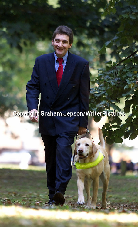 AUTHOR TOM PEY WITH HIS GUIDE DOG MARTIN.   <br />
