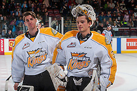 KELOWNA, CANADA - DECEMBER 3: Logan Thompson #1 and Jordan Papirny #33 of the Brandon Wheat Kings skate to the bench at the end of second period against the Kelowna Rockets on December 3, 2016 at Prospera Place in Kelowna, British Columbia, Canada.  (Photo by Marissa Baecker/Shoot the Breeze)  *** Local Caption ***
