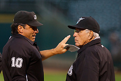 June 28, 2011; Oakland, CA, USA; Florida Marlins interim manager Jack McKeon (right) talks with MLB umpire Phil Cuzzi (10) before the game against the Oakland Athletics at the O.co Coliseum.  Oakland defeated Florida 1-0.