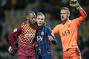 Wes Thomas (Bradford City), Ben Coker (Southend United) and Daniel Bentley (Southend United) during the Sky Bet League 1 match between Bradford City and Southend United at the Coral Windows Stadium, Bradford, England on 16 February 2016. Photo by Mark P Doherty.