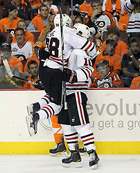 June 9, 2010; Philiadelphia, PA; USA;  Chicago Blackhawks right wing Patrick Kane (88) and Chicago Blackhawks left wing Andrew Ladd (16) celebrate Ladd's goal during the second period of Game 6 of the Stanley Cup Finals at the Wachovia Center.