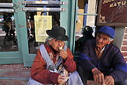 Campesino peasants taking ice cream break in Potosi, Bolivia