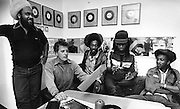 Aswad with Chris Blackwell signing contracts at Island Records Office 1980