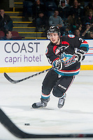 KELOWNA, CANADA - DECEMBER 5: Jesse Lees #2 of Kelowna Rockets passes the puck against the Prince George Cougars on December 5, 2014 at Prospera Place in Kelowna, British Columbia, Canada.  (Photo by Marissa Baecker/Shoot the Breeze)  *** Local Caption *** Jesse Lees;
