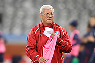 CAPE TOWN, SOUTH AFRICA - 13 JUNE 2010, Italian coach Marcello Lippi hands out bibs  during Italy's training session held at the Cape Town Stadium. Italy play Paraguay in Match 11 of the 2010 FIFA World Cup on Monday 14 June 2010. Photo by: Shaun Roy/Sportzpics