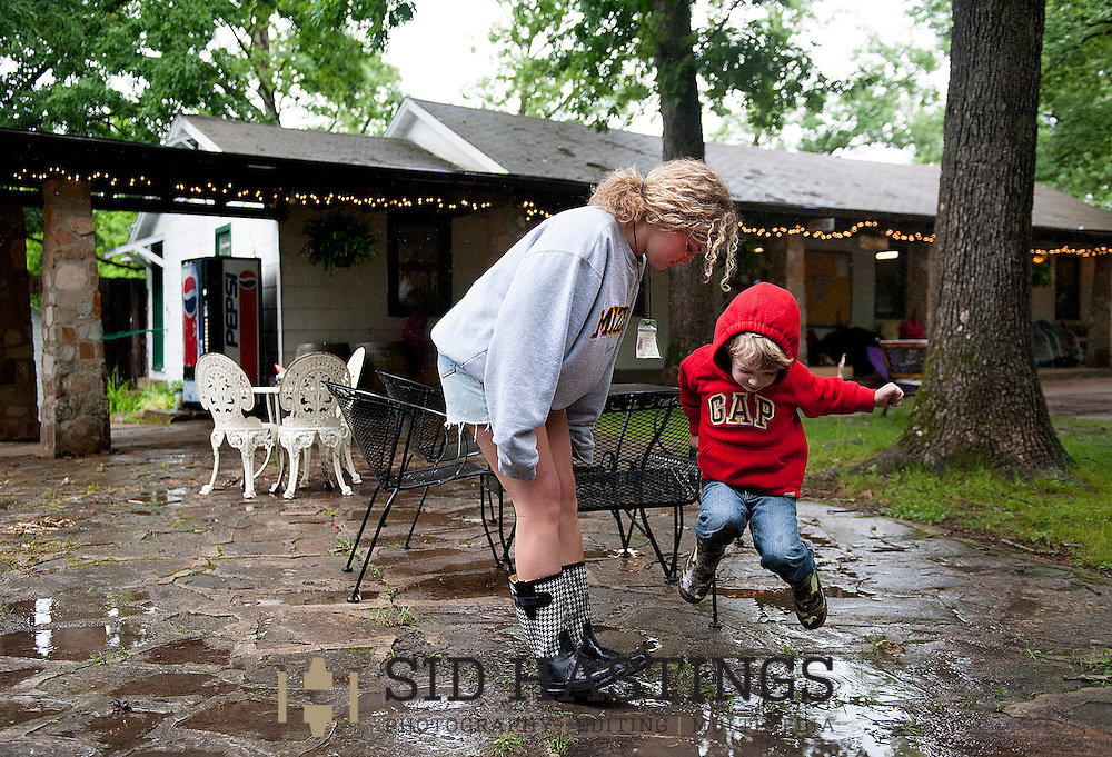 1 JUNE 2013 -- STEELVILLE, Mo. -- Bailey Bestgen (left) and her 3-year-old brother Gus play in puddles after a rain during Sacred Heart Family Camp 2013 at Eagle Hurst Ranch in Steelville, Mo. Saturday, June 1, 2013. Photo © copyright 2013 Sid Hastings.