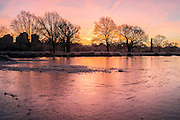 UNITED KINGDOM, London: 18 January 2017 The reflection of sunrise can be seen in a frozen lake in Richmond Park during sunrise this morning. Temperatures dropped to -4C in certain parts of the capital last night causing wide spread frost. Rick Findler / Story Picture Agency