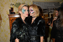Left to right, LOUISA PRESKETT and ZOE JORDAN at the Bumpkin Halloween Dinner hosted by Marissa Hermer held at Bumpkin, 119 Sydney Street, London on 23rd October 2014.