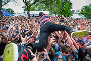 DETROIT – MAY 24: Nick Hood from New York crowd surfs while his friend Hudson Mohawke plays the Red Bull stage during day 2 of the Movement Electronic Music Festival Sunday, May 24, 2015 at Hart Plaza in downtown Detroit. (Photo by Bryan Mitchell for Paxahau)