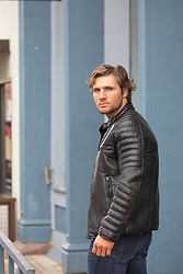 hot man in a leather jacket outdoors