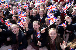 Pupils from the Trinity School in Sevenoaks wave flags during the Lizzy Yarnold victory bus tour through Sevenoaks, Kent.