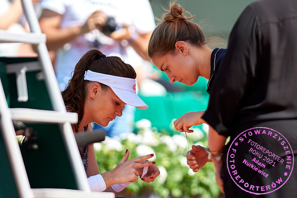 Paris, France - 2017 June 01: Agnieszka Radwanska from Poland injured uses medical help during her women's single match second round during tennis Grand Slam tournament The French Open 2017 (also called Roland Garros) at Stade Roland Garros on June 01, 2017 in Paris, France.<br /> <br /> Mandatory credit:<br /> Photo by &copy; Adam Nurkiewicz<br /> <br /> Adam Nurkiewicz declares that he has no rights to the image of people at the photographs of his authorship.<br /> <br /> Picture also available in RAW (NEF) or TIFF format on special request.<br /> <br /> Any editorial, commercial or promotional use requires written permission from the author of image.