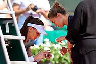 Paris, France - 2017 June 01: Agnieszka Radwanska from Poland injured uses medical help during her women's single match second round during tennis Grand Slam tournament The French Open 2017 (also called Roland Garros) at Stade Roland Garros on June 01, 2017 in Paris, France.<br /> <br /> Mandatory credit:<br /> Photo by © Adam Nurkiewicz<br /> <br /> Adam Nurkiewicz declares that he has no rights to the image of people at the photographs of his authorship.<br /> <br /> Picture also available in RAW (NEF) or TIFF format on special request.<br /> <br /> Any editorial, commercial or promotional use requires written permission from the author of image.