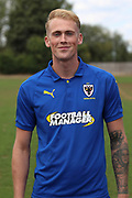 AFC Wimbledon midfielder Mitchell (Mitch) Pinnock (11) during the AFC Wimbledon 2018/19 official photocall at the Kings Sports Ground, New Malden, United Kingdom on 31 July 2018. Picture by Matthew Redman.