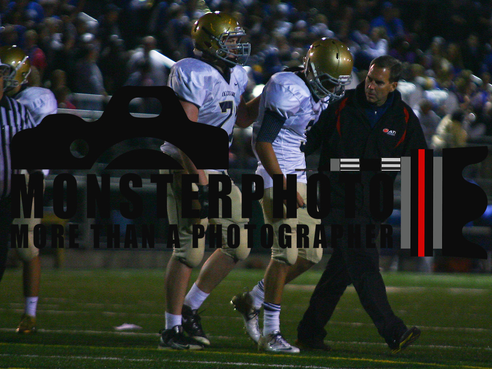 10/26/12 - Wilmington, DE - Middletown Football -Salesianum quarterback Matthew Sgro (3) is assisted off the field by a Salesianum trainer during a Week 8 DIAA football game against Middletown Friday, Oct. 26, 2012, at Cavaliers Stadium in Middletown DE.   ..SAQUAN STIMPSON/Special to The News Journal