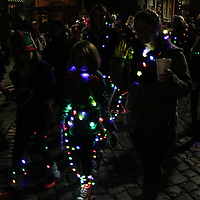 The Girl Scouts North Carolina Coastal Pines participate in the 12th Annual Wilmington Holiday Parade Sunday December 7, 2014 in Wilmington, N.C. (Jason A. Frizzelle)