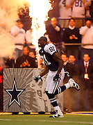 IRVING, TX - NOVEMBER 29: Wide receiver Terrell Owens #81 of the Dallas Cowboys grimaces as he runs onto the field and gets pumped up during pregame introductions with a fire backdrop at the game against the Green Bay Packers on November 29, 2007 at Texas Stadium in Irving, Texas. The Cowboys defeated the Packers 37-27. ©Paul Anthony Spinelli *** Local Caption *** Terrell Owens
