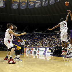 November 12, 2011; Baton Rouge, LA; LSU Tigers guard Ralston Turner (22) shoots over Nicholls State Colonels guard Trevon Lewis (23) during the first half of a game at the Pete Maravich Assembly Center.  Mandatory Credit: Derick E. Hingle-US PRESSWIRE