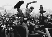 In the mosh pit, Lollapalooza concert-goers undulate to the rhythm and pass moshers over their heads to the front of the stage. (Tom Reese / The Seattle Times, 1992)
