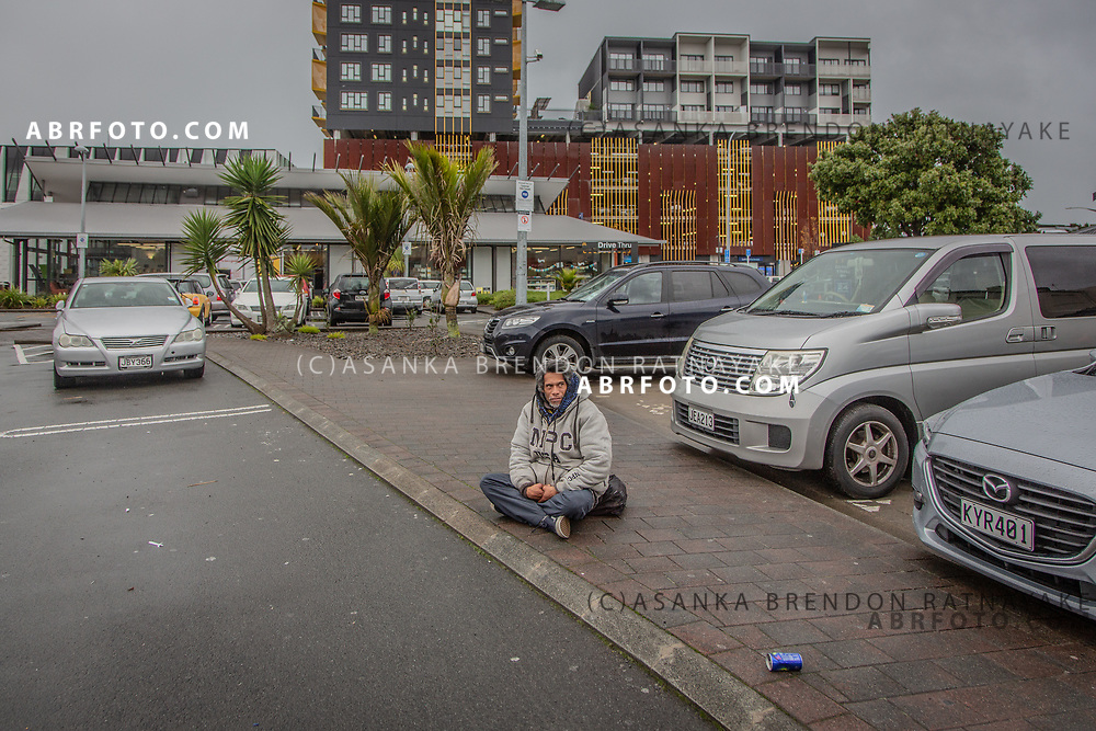 Joseph Takairangi sits down and rests in a carpark in New Lynn in the west of Auckland on the 6th of June 2018. Joseph Takairangi suffers from Asthma and prone to Asthma attacks during the cold winter periods. Asanka Brendon Ratnayake for The New York Times.