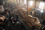 """Produktion """"Schweitzer"""".Photo © Stefan Falke / NFP...Schweitzer (Jeroen Krabbe).rehearsal..43 DAY 11.INT.PORT GENTIL DOCKS - WAREHOUSE.Schweitzer finds some delayed crates in the.Warehouse..."""