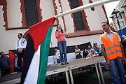 Frankfurt am Main | 26 July 2014<br /> <br /> Am Samstag (26.07.2014) demonstrierten etwa 500 Menschen auf dem R&ouml;merberg in Frankfurt am Main f&uuml;r Frieden in Pal&auml;stina / Gaza und f&uuml;r ein sofortiges Ende der israelischen Milit&auml;reins&auml;tze dort.<br /> Hier: Der Ordnerdienst des Veranstalters passt auf, Janine Wissler (Linkspartei, Die Linke) h&auml;lt eine Rede, vorne weht die pal&auml;stinensische Fahne.<br /> <br /> &copy;peter-juelich.com<br /> <br /> FOTO HONORARPFLICHTIG!<br /> <br /> [No Model Release | No Property Release]