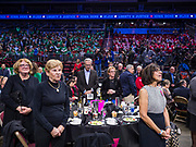 01 NOVEMBER 2019 - DES MOINES, IOWA: People stand for the opening prayer at the Liberty and Justice Celebration in the Wells Fargo Arena in Des Moines. The Liberty and Justice Celebration is a fund raiser for the Iowa Democratic Party. Many of the Democratic candidates for the US presidency spoke at the 2019 Celebration. Iowa holds the first presidential selection event of the 2020 election cycle. The Iowa Caucuses are Feb. 3, 2020.          PHOTO BY JACK KURTZ