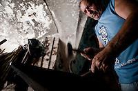 2 Luglio 2012, Vignacastrisi (Ortelle) Lecce..Laboratorio di Nunzio Casciaro, il fabbro inventore salentino noto per la sue invenzioni stravaganti costruite artigianalmente in ferro battuto.