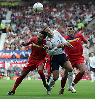 Photo: Paul Thomas.<br /> England v Andorra. European Championships 2008 Qualifying. 02/09/2006.<br /> <br /> Phil Neville (C) of England battles with Manel Jimenez (L) and Fernando Jose Silva.