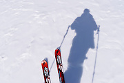 Skis and silhouetted skier, John Muir Wilderness, Sierra Nevada Mountains, California