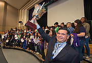 Rene Shanchez hoists the national championship cup during the 2015-2016 Vocablary Bowl Trophy presentation at Chavez High School, May 9, 2016.