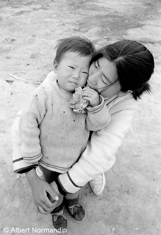 A private moment with a mother and child, child looking