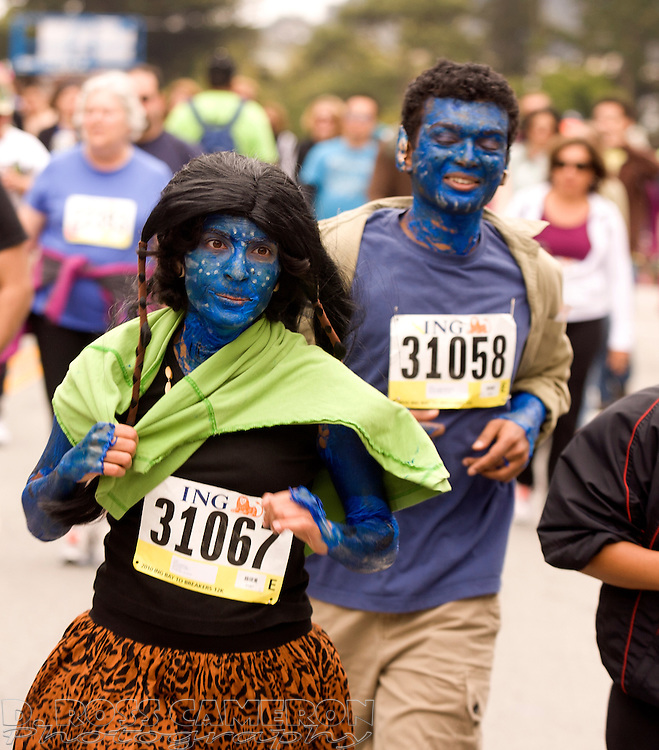 """Costumed as characters from the popular film """"Avatar,"""" Kavya Rakhra, left, and Sridhar Venkatakrishnan make their way through Golden Gate Park at the 99th running of the Bay to Breakers 12K race, Sunday, May 16, 2010 in San Francisco. (Photo by D. Ross Cameron)"""
