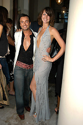 JULIEN MACDONALD and MARGO STILLEY at the Tatler Summer Party in association with Moschino at Home House, 20 Portman Square, London W1 on 29th June 2005.<br /><br />NON EXCLUSIVE - WORLD RIGHTS